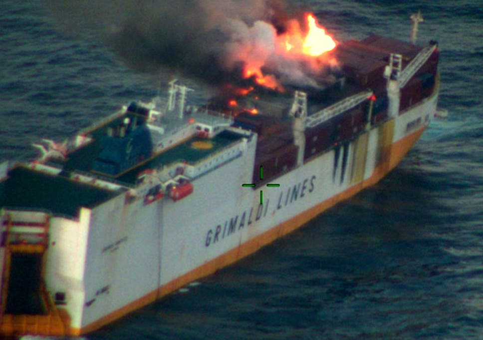 France battling to contain six-mile fuel slick after cargo ship
