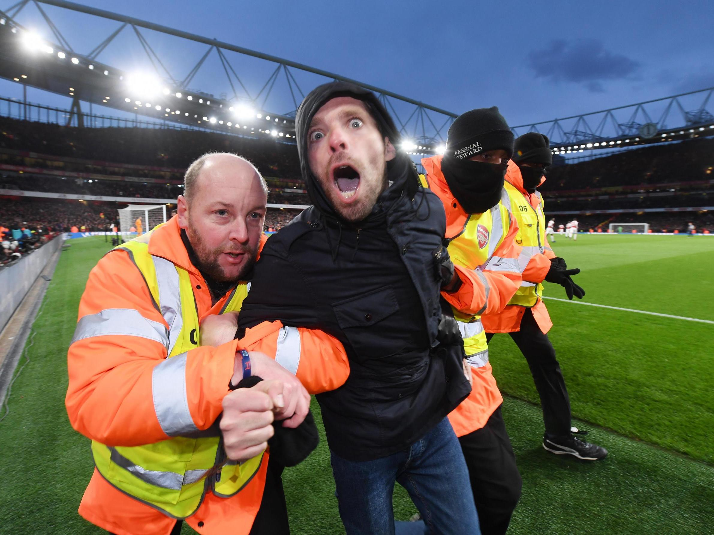 Arsenal charged by FA over fan pitch invasion during Manchester United victory