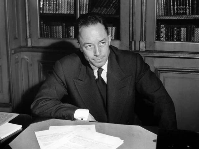 Posing for a portrait in Paris following the announcement of his Nobel Prize triumph in 1957