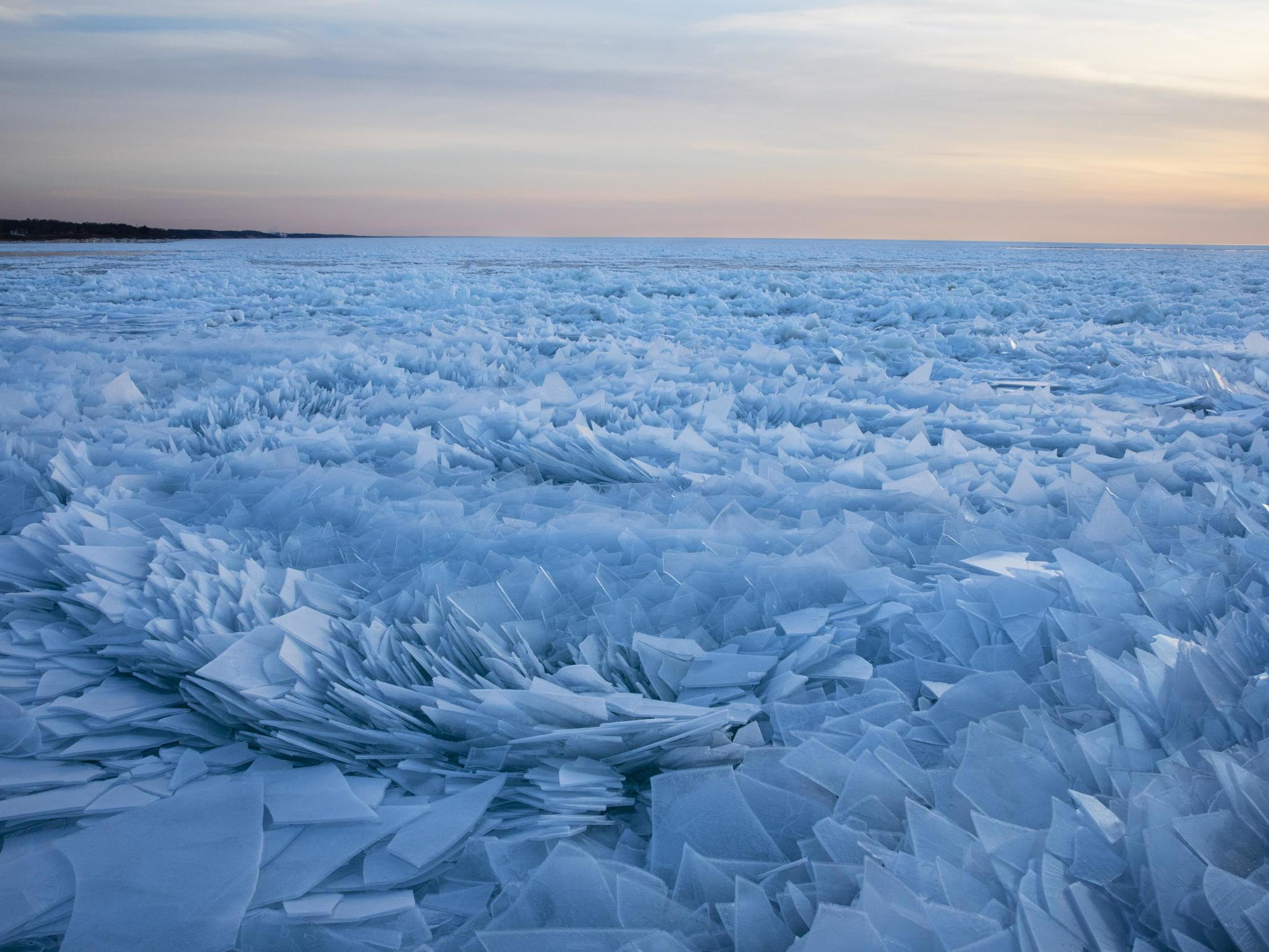 Lake Michigan covered in ice shards in mesmerising new pictures as spring arrives