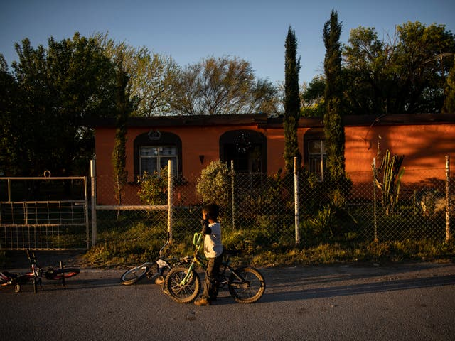 A boy rides a bike at sunset in Nacimiento