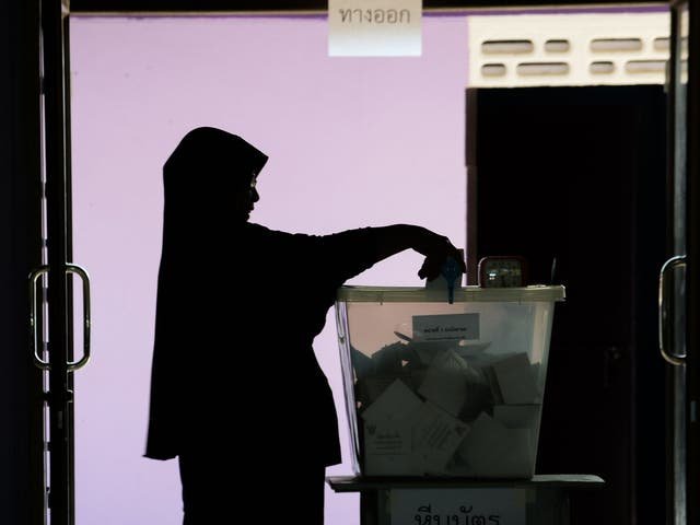 A woman casts her ballot at a polling station in Narathiwat on March 24, 2019 during Thailand's general election.