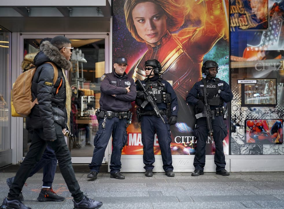 Members of the New York City Police (NYPD) Counter-terrorism unit patrol stand watch in Times Square 18, March 2019 in New York City.