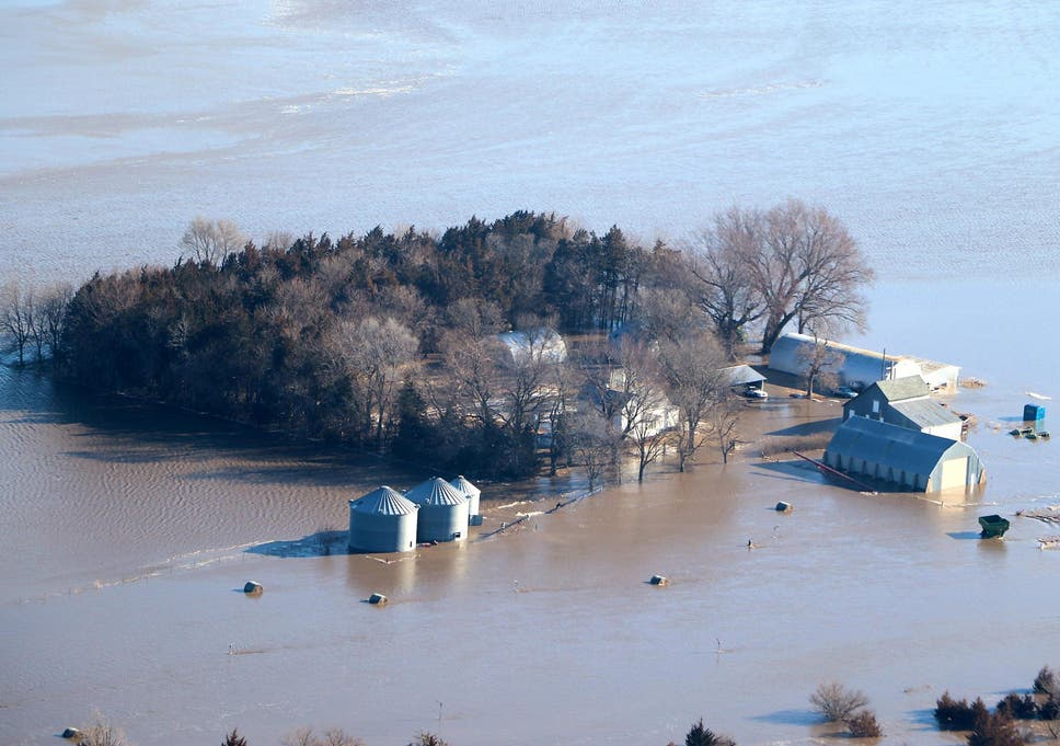 US weather: States reel from historic floods as fresh snow