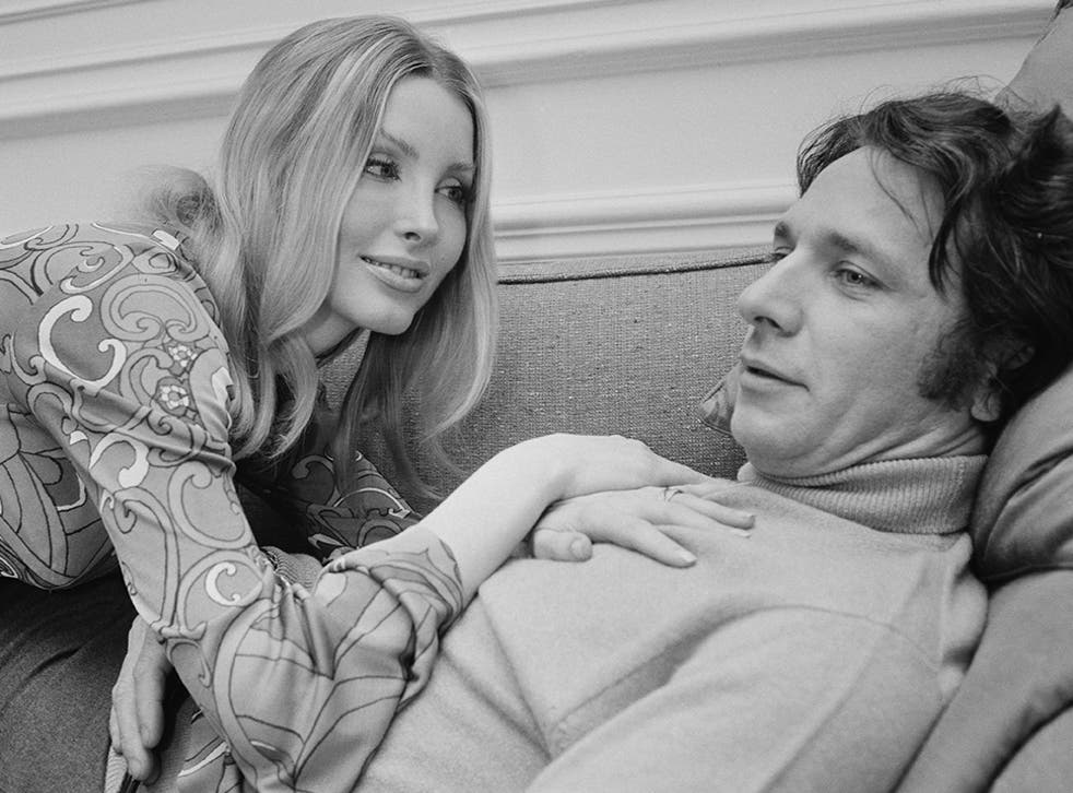 The French composer and conductor with his wife, American actress Laura Devon, in 1968