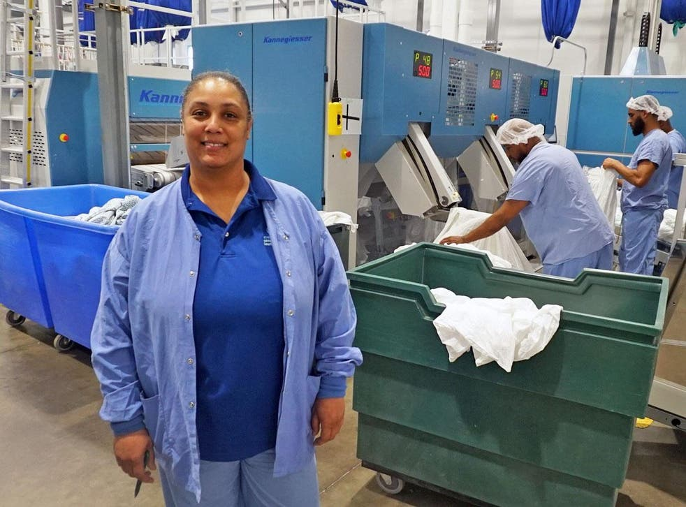Tymika Thomas owns a share of Evergreen Cooperative Laundry