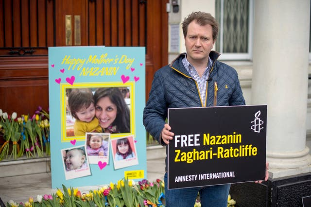 Richard Ratcliffe delivers a giant Mother's Day card and bunches of flowers to the steps of the Iranian embassy in London as he continues to campaign for his wife's release from prison