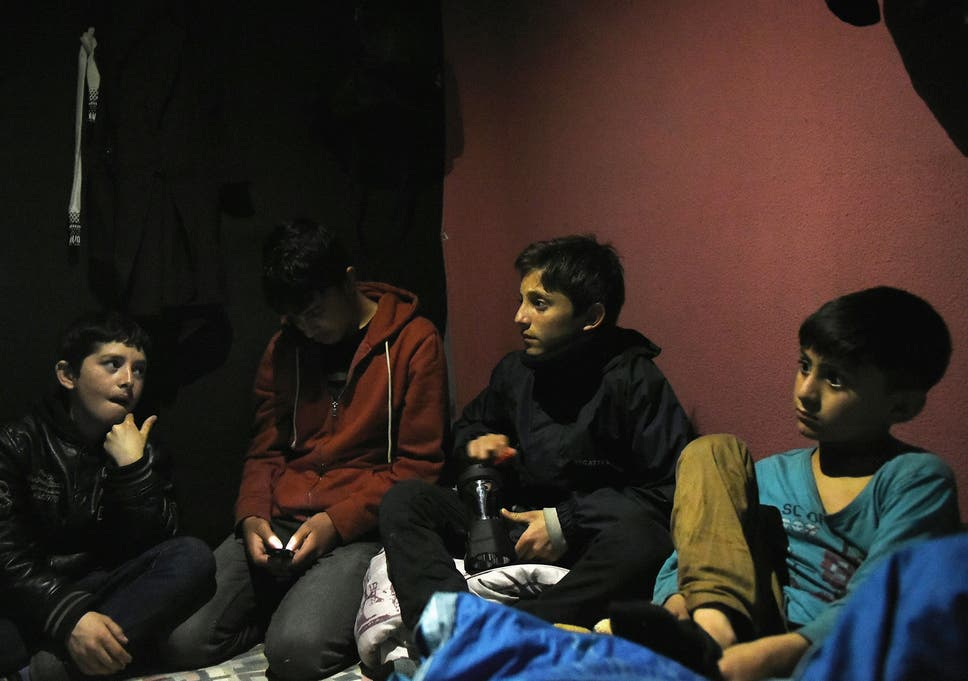 A group of unaccompanied child asylum seekers from Afghanistan at The Jungle migrant camp in Calais