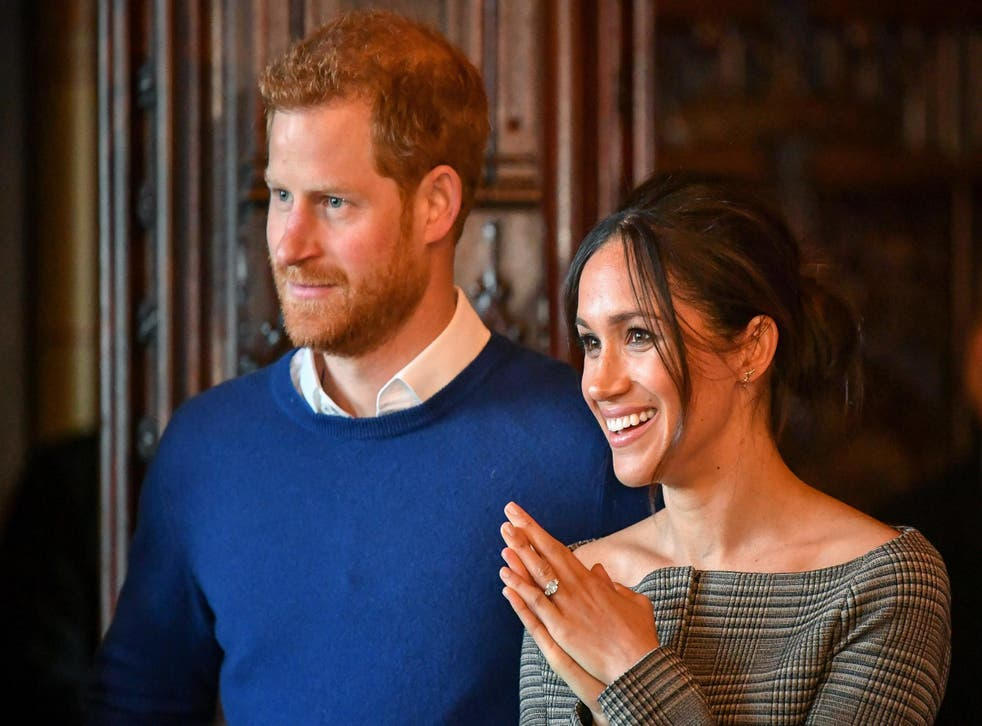Prince Harry and Meghan Markle watch a performance by a Welsh choir in the banqueting hall during a visit to Cardiff Castle on 18 January 2018
