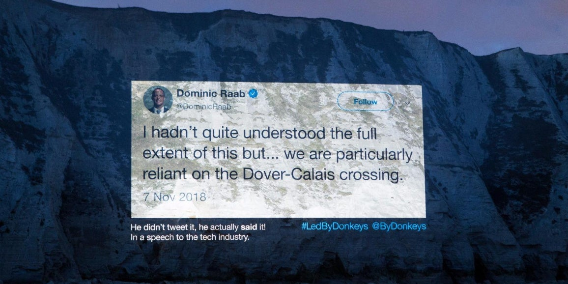 A giant projection on the White Cliffs of Dover is calling out Brexiteers