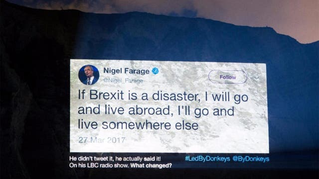 Campaign group Led By Donkeys projected this statement by Nigel Farage on the Cliffs of Dover on the evening of April 4
