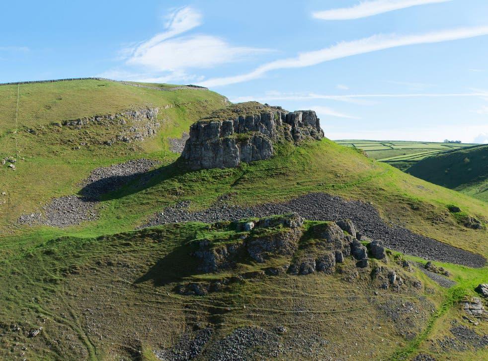 Peter's Stone rises like an island towards the head of Cressbrook Dale