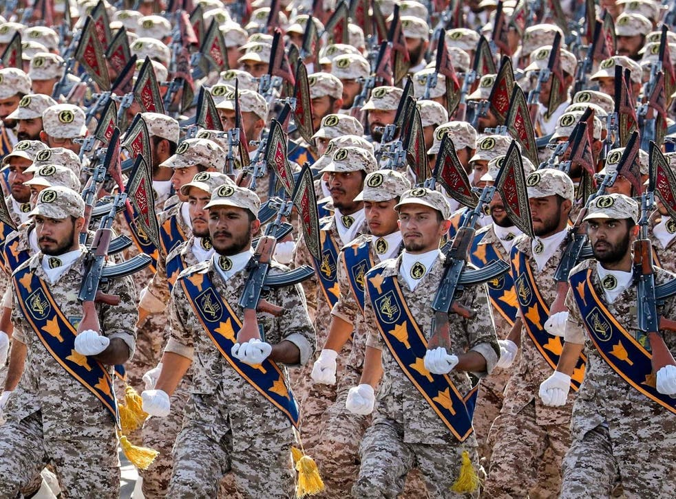 Members of Iran's Revolutionary Guards Corps (IRGC) march during the annual military parade marking the anniversary of the outbreak of the devastating 1980-1988 war with Saddam Hussein's Iraq, in the capital Tehran