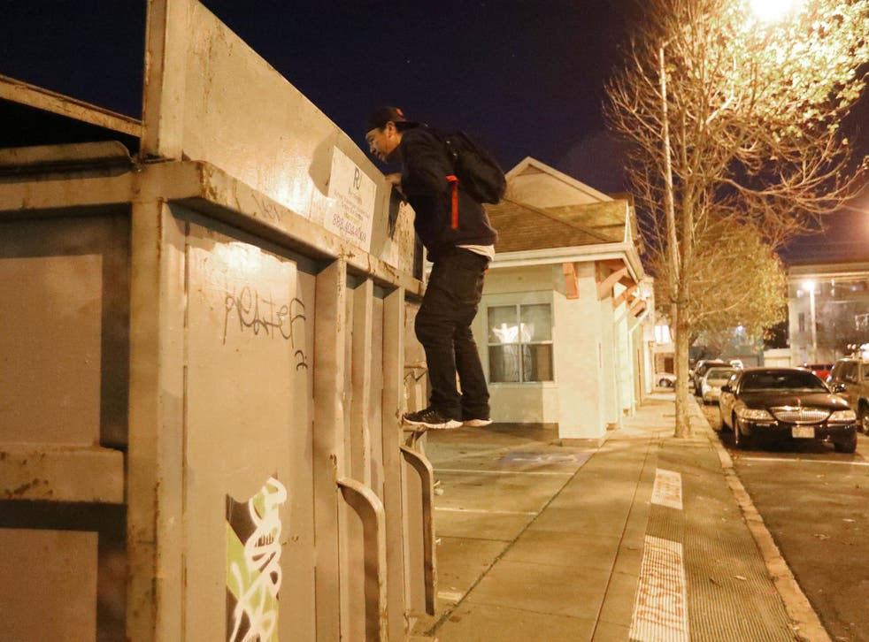 Jake Orta peers into a dumpster in San Francisco on 25 Jan, 2019