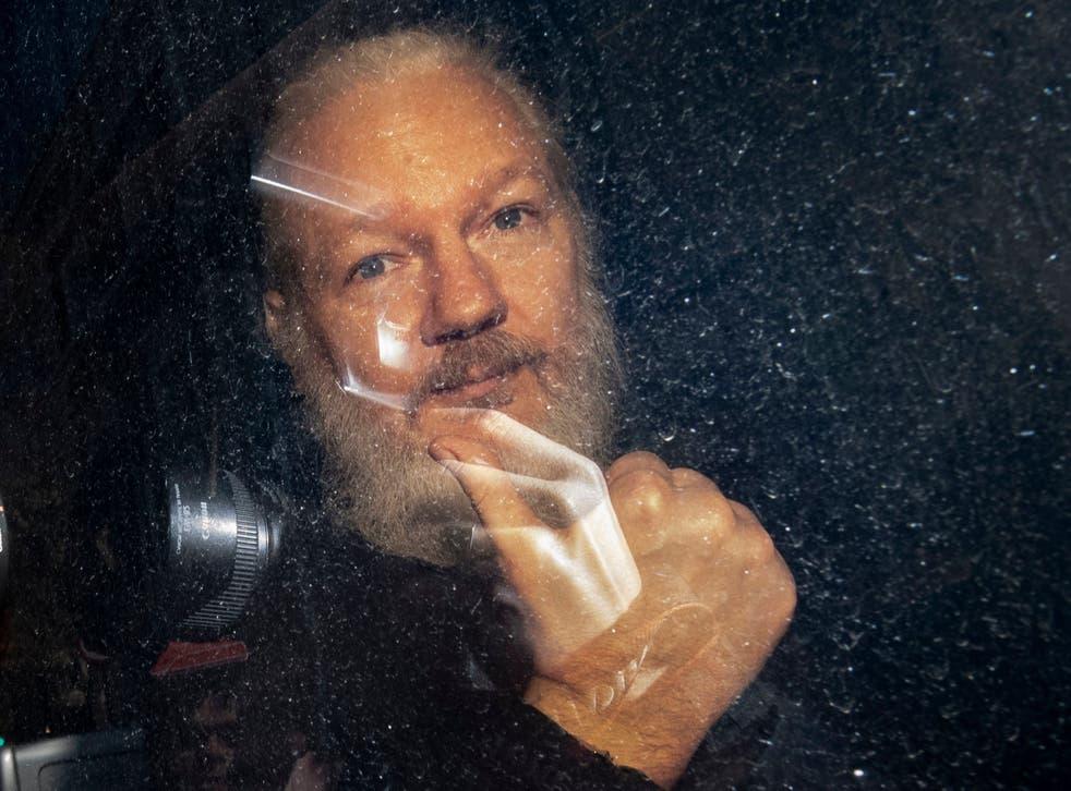 WikiLeaks founder Julian Assange arrives at Westminster Magistrates' Court in London after his arrest on 11 April 2019.