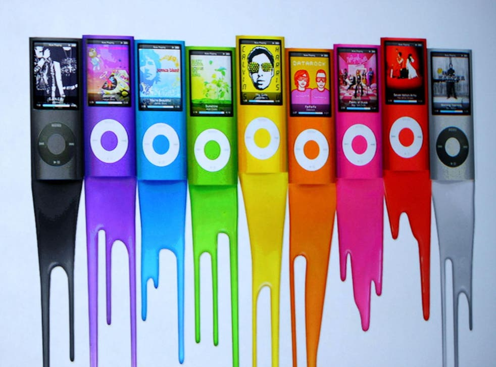 An ad shows colors of the new iPod Nano as Apple CEO Steve Jobs speaks during a special event September 9, 2008 in San Francisco, California