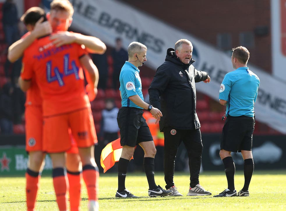 Chris Wilder confronts the ref after Millwall's late goal