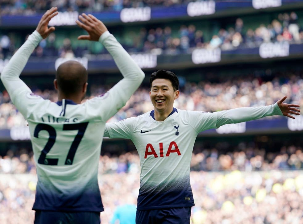 Son Heung-min, right, celebrates with Lucas Moura against Huddersfield
