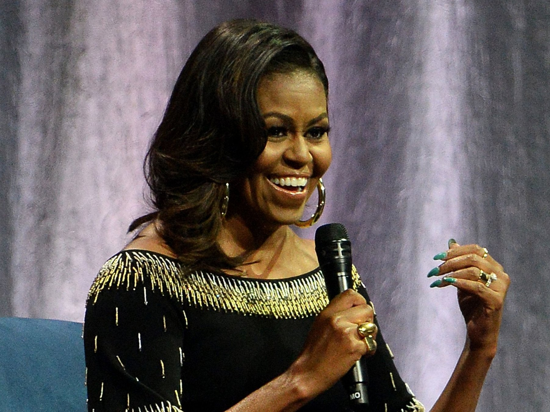 Michelle Obama compares Donald Trump to 'divorced dad' in