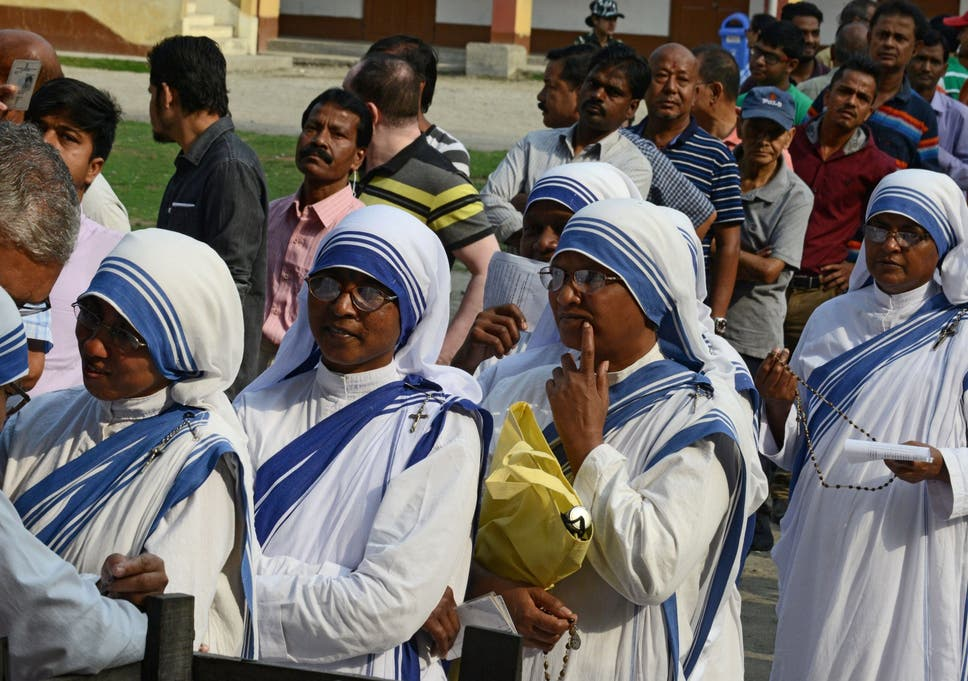 445a900ed11 Indian voters queue up to cast their vote at a polling station in Siliguri