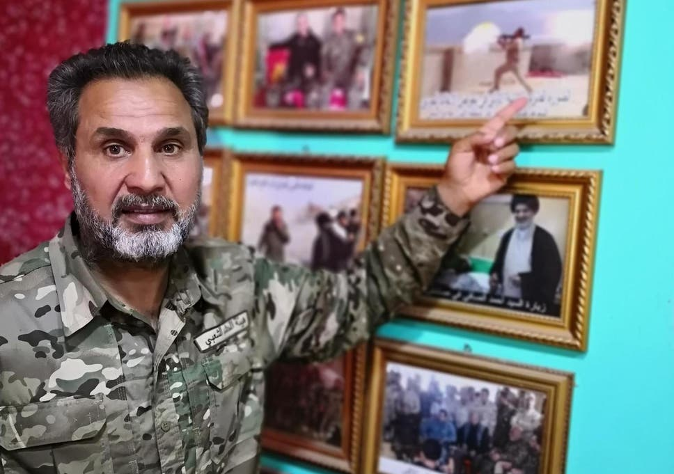 Walking wounded: veteran Tammy al-Yasaari with his war photo exhibition at home in Kerbala