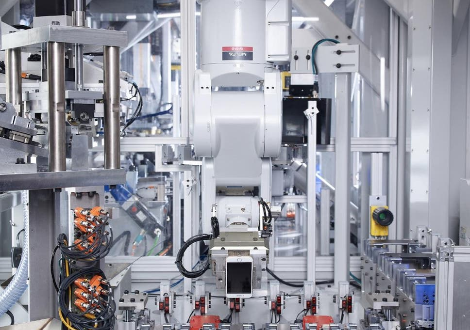 Apple shows off robot for tearing down iPhones as it reveals