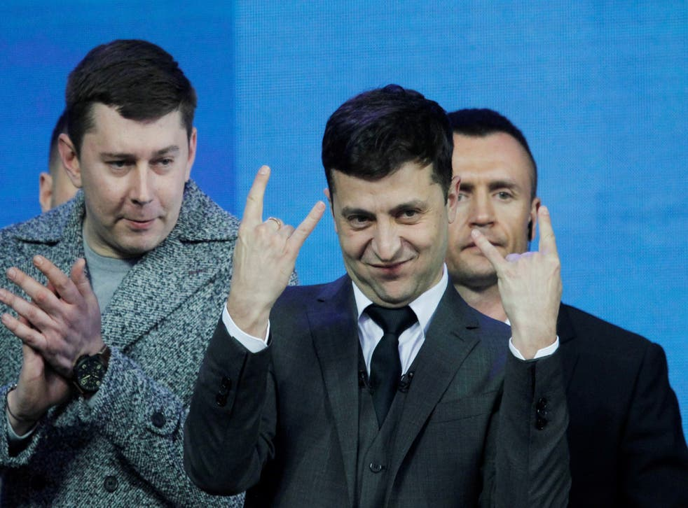 Volodymyr Zelensky (centre) gestures during a debate with Ukrainian president Petro Poroshenko