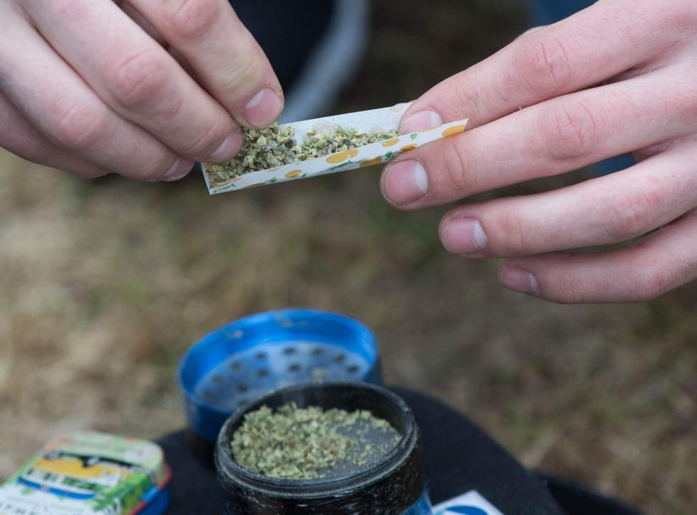A marijuana cigarette is prepared during the annual 4/20 rally on Parliament Hill in Ottawa, Ontario, on 20 April 2019.