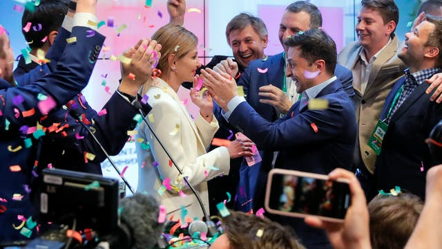 Volodymyr Zelenskiy, centre right, and his wife Olena Zelenska, greet supporters after exit polling gave the comedian a commanding lead