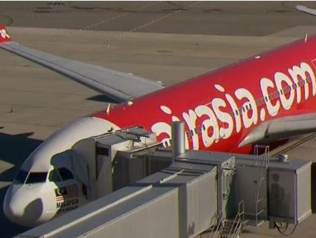 Medical staff and police officers met the Air Asia plane when it landed
