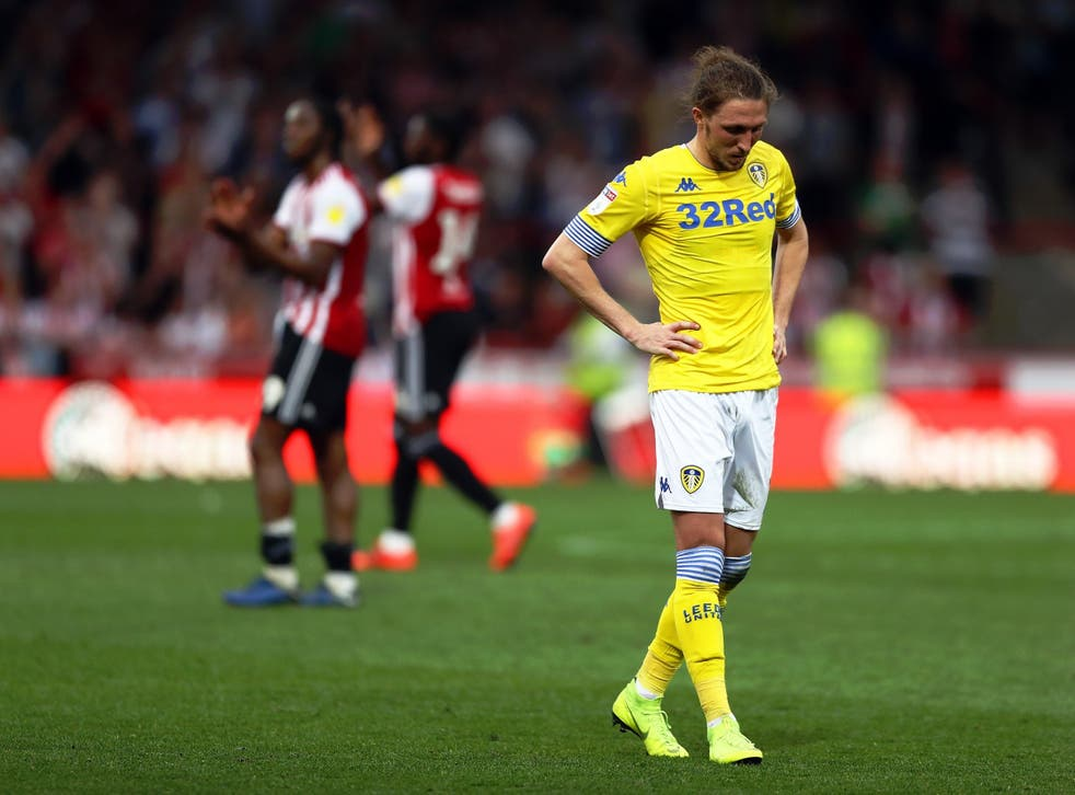 A dejected Luke Ayling looks on after defeat at Griffin Park