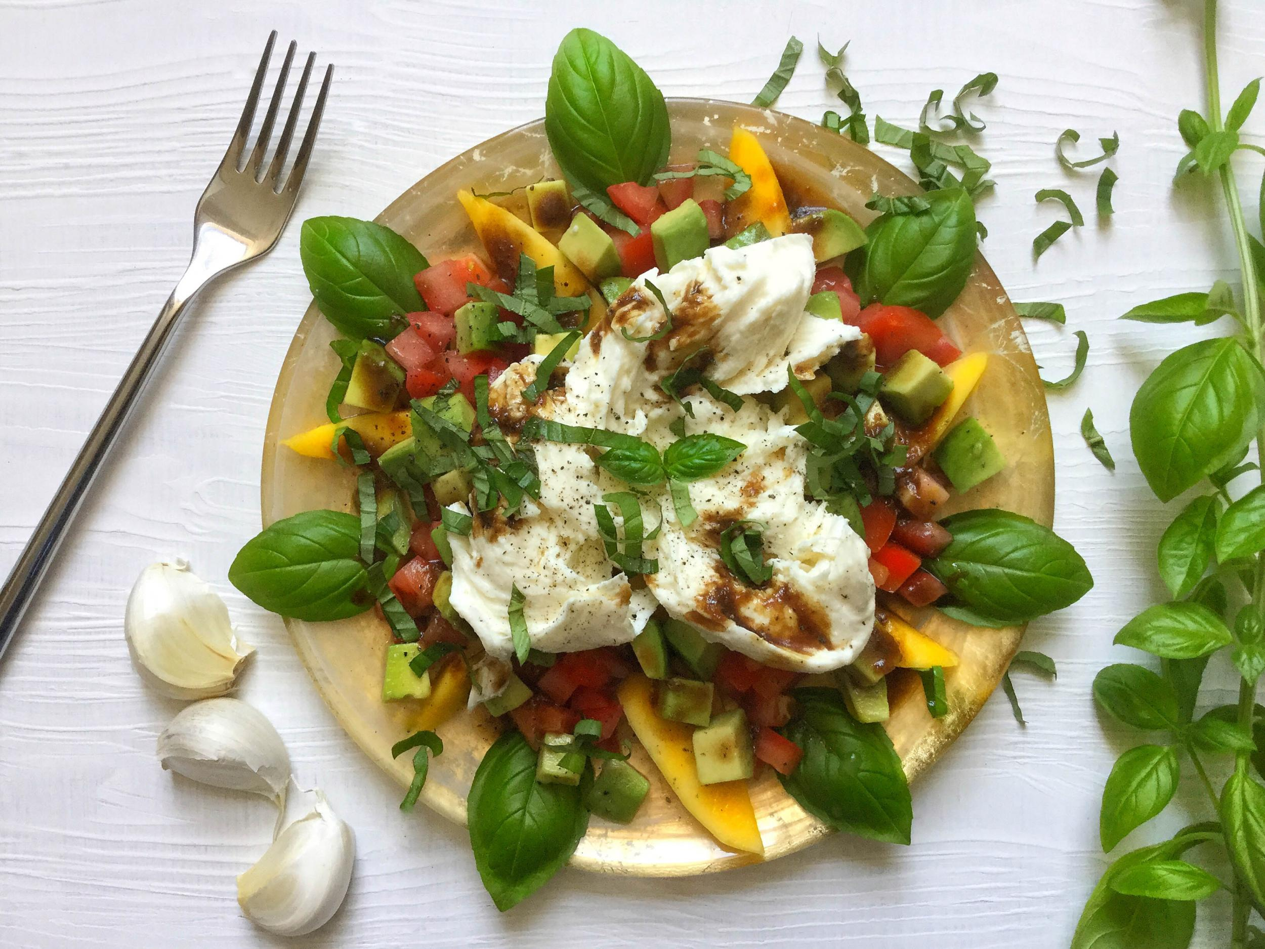 How to make mango and avocado caprese salad with balsamic tahini dressing