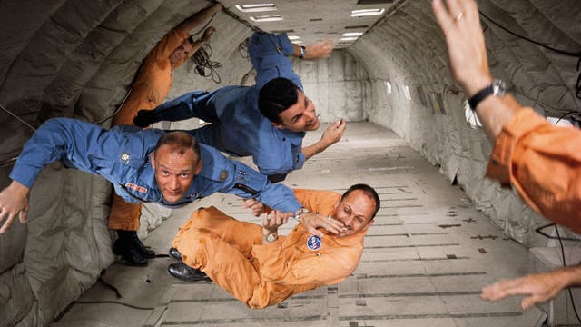 New astronauts Ted Freeman, Buzz Aldrin (centre) and Charlie Bassett experience zero gravity in Nasa's KC135 aircraft – affectionately known as the Vomit Comet