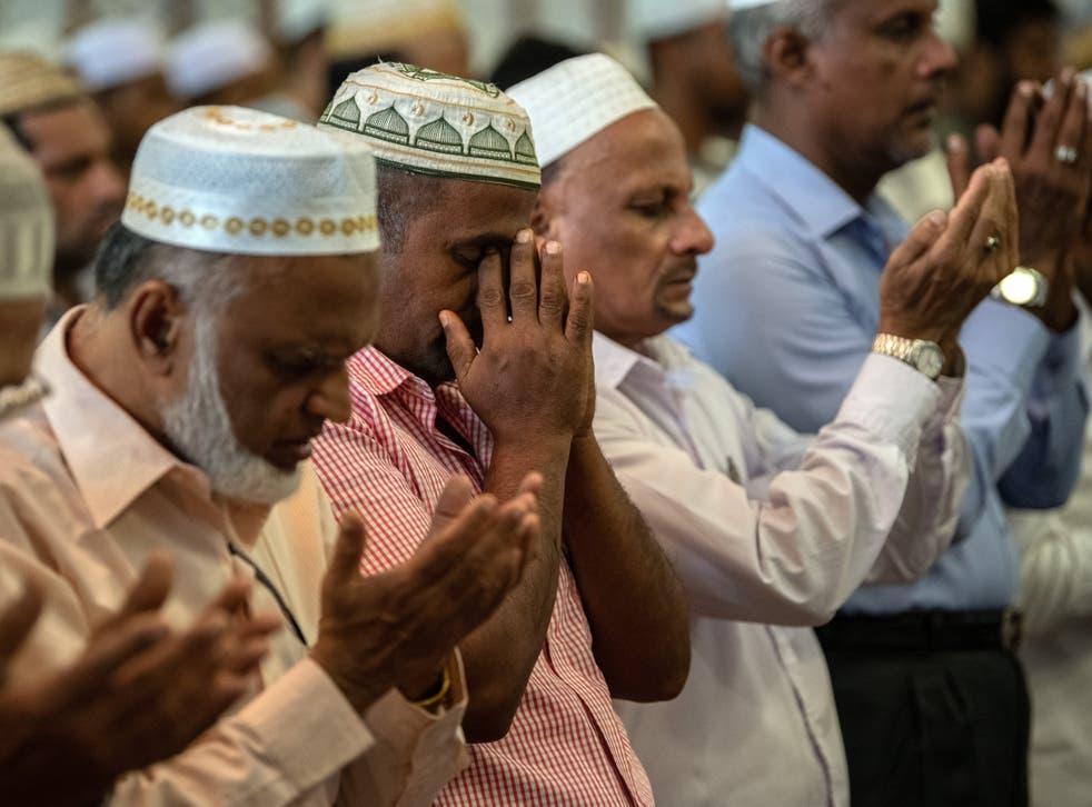 Muslim worshippers attend Friday prayers at Dawatagaha Jumma Masjid in Colombo, Sri Lanka