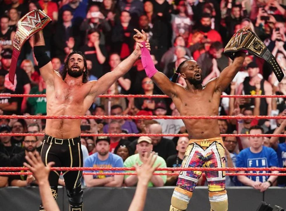 Seth Rollins and Kofi Kingston celebrate