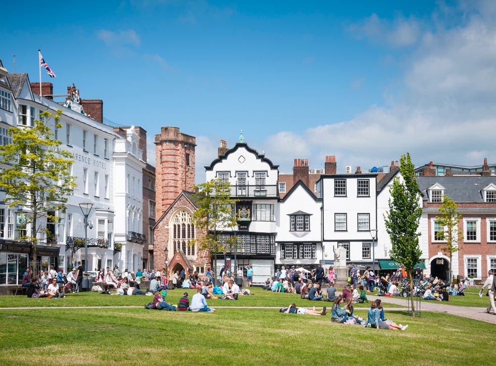 People relaxing on Exeter's cathedral green