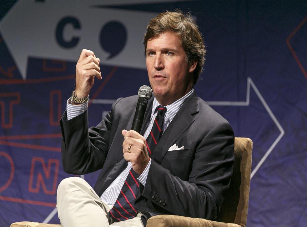 Tucker Carlson speaks during Politicon 2018