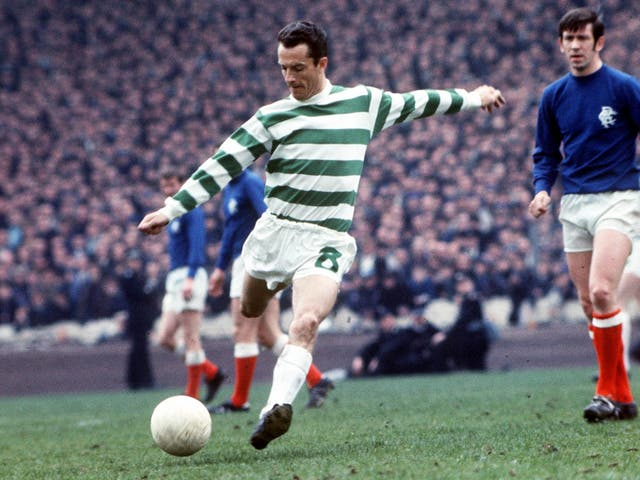 Chalmers in action against Rangers (and their captain John Greig, right) in 1969