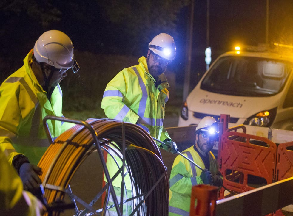 Cabling up under floodlights: BT has promised to speed up fibre broadband connections while maintaining its dividend