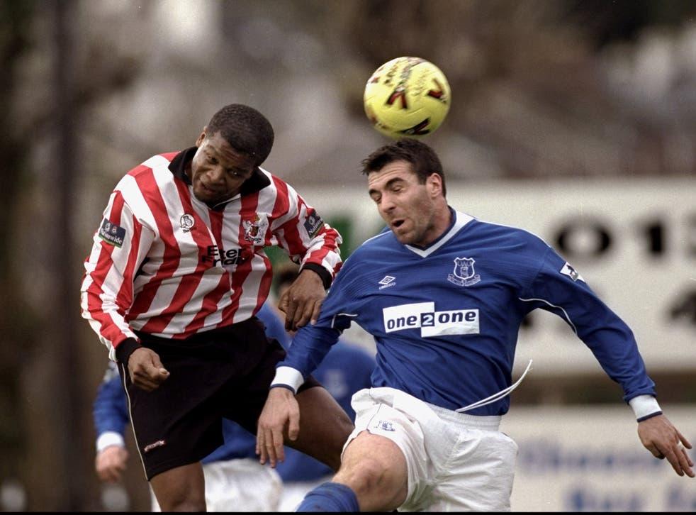 Jon Gittens (L) playing for Exeter against Everton in 1999