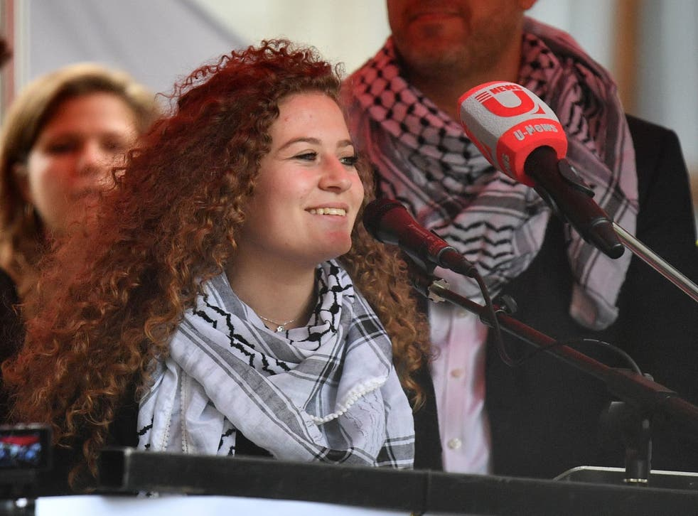 Palestinian activist Ahed Tamimi speaks at a rally calling for justice for Palestinians amid a growing threat of further war in the Middle East in central London on 11 May 2019