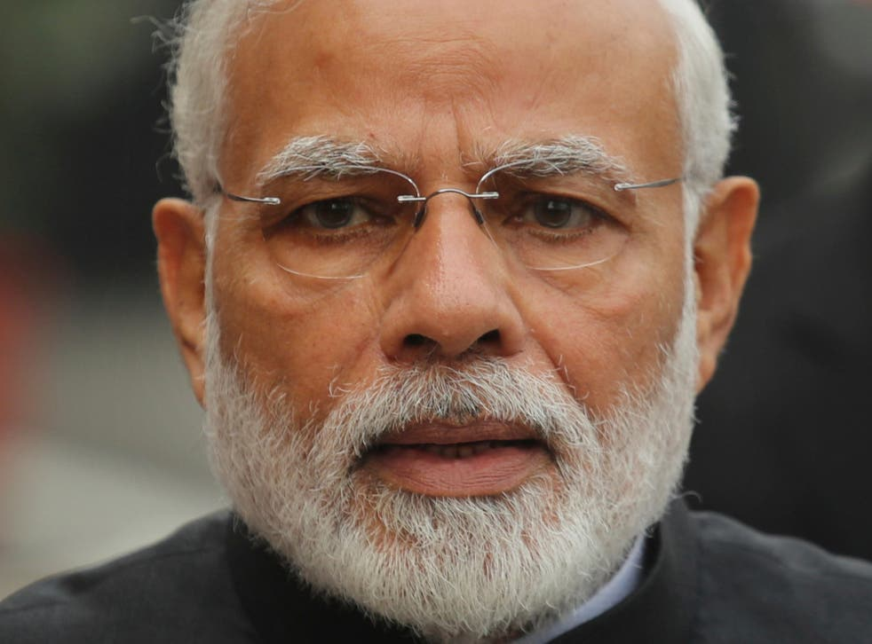 India's Modi has galvanised popular support behind him, but critics say he has divided the country along religious faultlines