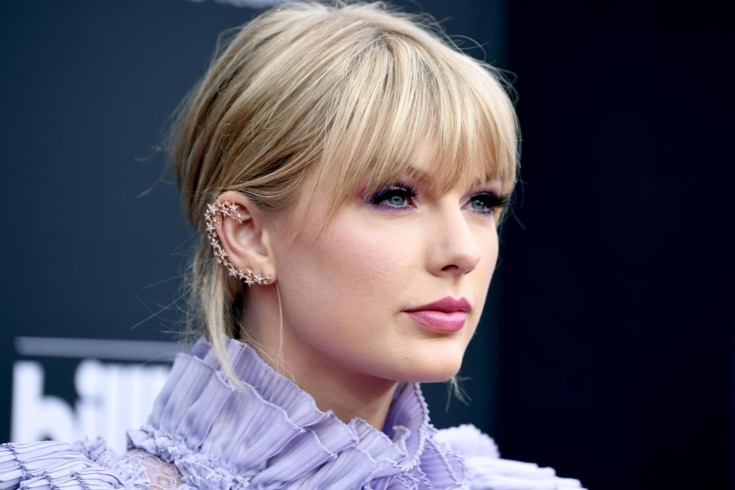 Taylor Swift's former label to re-release her old singles amid fan backlash and high-profile feuds