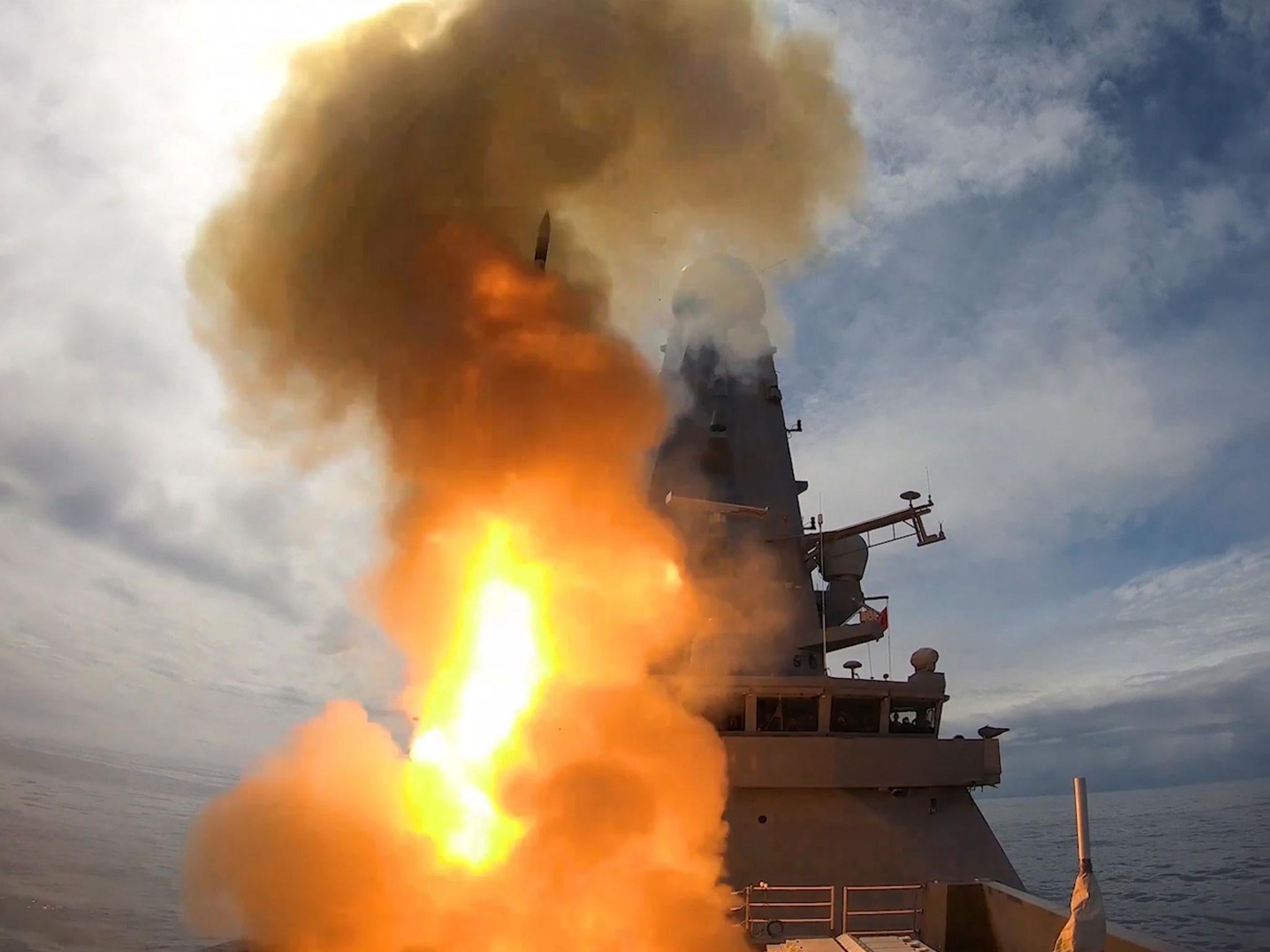 In a burst of fire and smoke, Royal Navy warship HMS