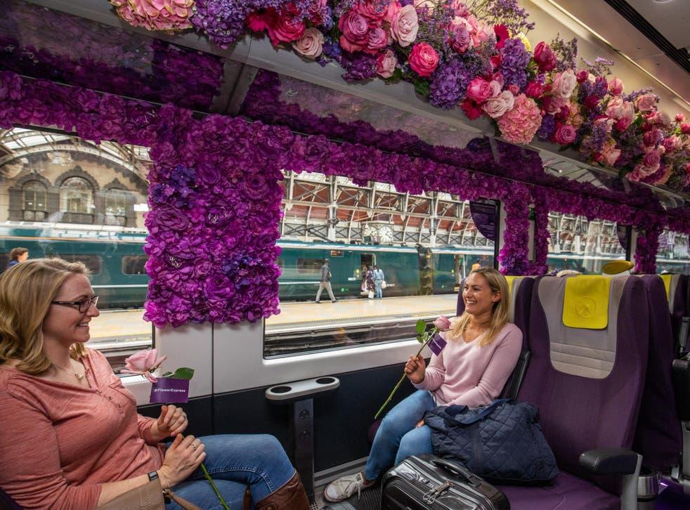 Passengers admire the Heathrow Flower Express