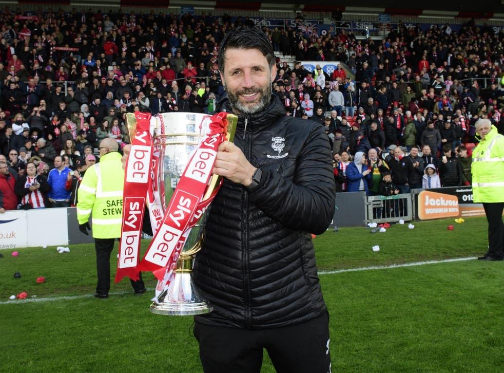Danny Cowley celebrates with the League Two trophy