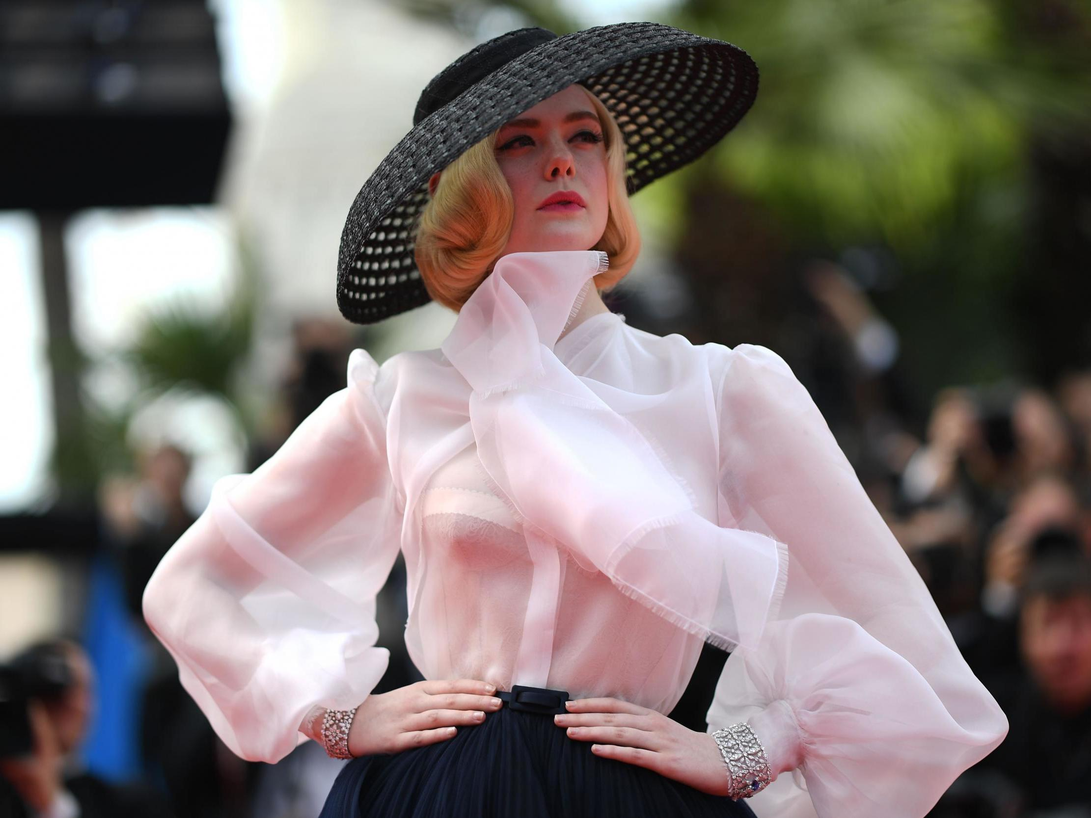 3477ff89feca12 Cannes 2019: Elle Fanning wows on red carpet in couture Dior shortly after  fainting at film festival | The Independent