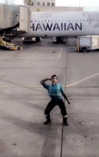 Hawaii baggage handler filmed dancing on tarmac while directing plane