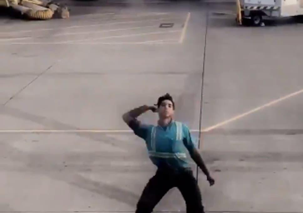 4c0d12b9fdbb Hawaii baggage handler filmed dancing on tarmac while directing plane. '
