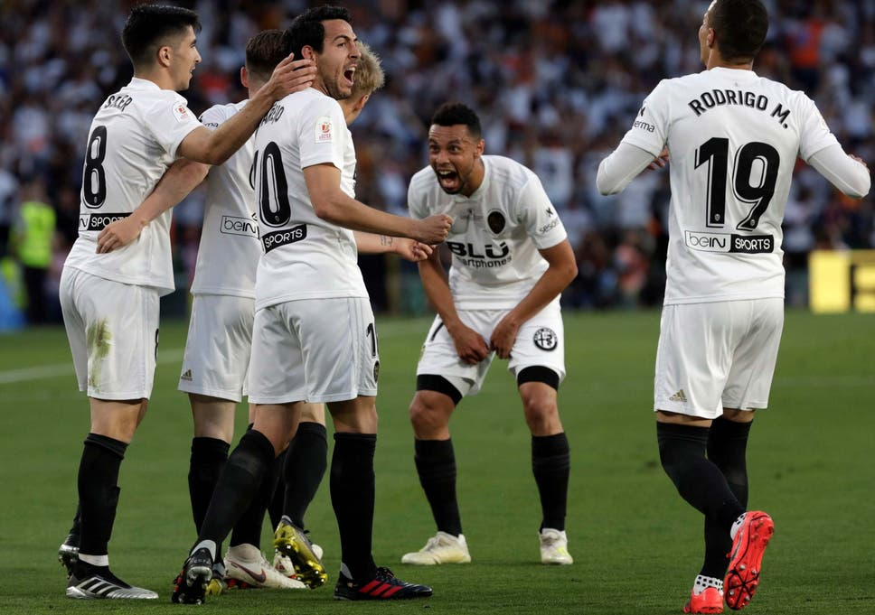 Valencia's players celebrate after the final whistle